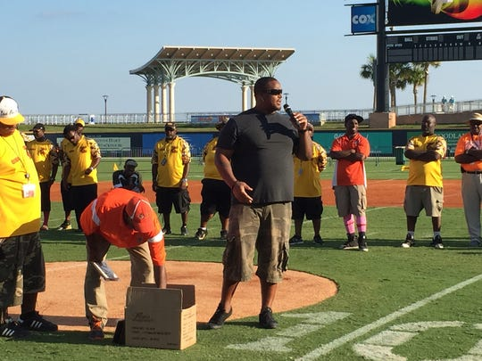Fred Robbins, a Tate and Wake Forest graduate and former New York Giants standout, addresses youth football players during a break in annual Soul Bowl Oct. 10 at Blue Wahoos Stadium.