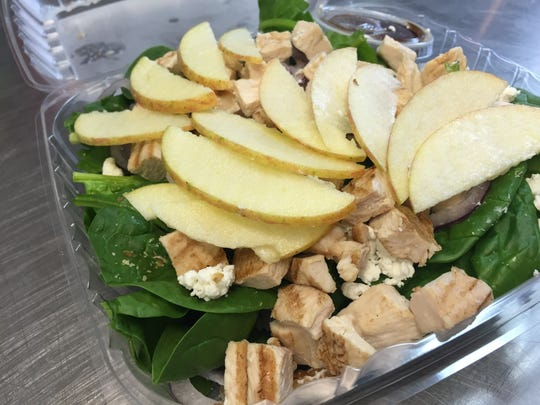 The chicken breast on this spinach, walnut, Fuji Apple, red onion and goat cheese salad is cooked in-house.