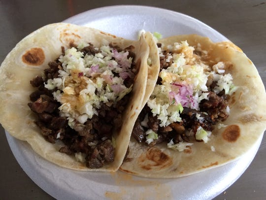 Backyard Taco's menu features tacos, quesadillas, burritos,