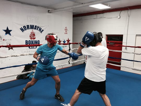 Jeff Styers, right, spars with his training partner at Norwayne Boxing Club.