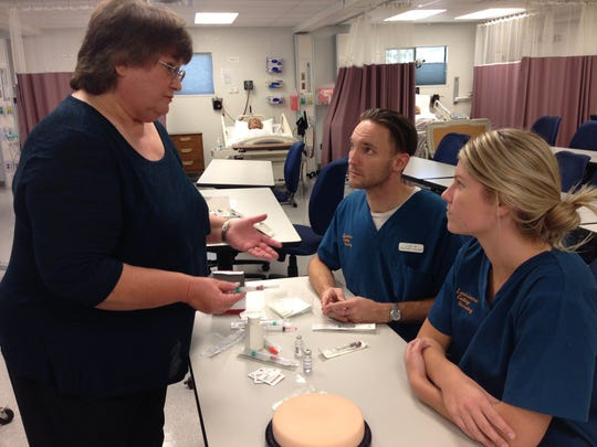 Marilyn Cooksey (left), dean of Louisiana College's division of nursing, talks with students Jon Lee and Alyson Birgel about injections during clinicals.