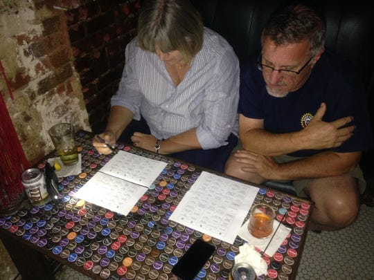 Lisa and Bill McGill play Democratic Debate Bingo at Bear's on Fairfield in Shreveport.
