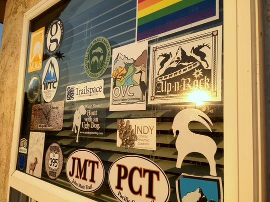 The office door at Mt Williamson Motel and Base Camp in Independence, Calif., celebrates the John Muir and Pacific Crest trails and bighorn sheep. When Cris Chater, trail name Strider, took over two years ago she turned it into a hiker-centric destination.