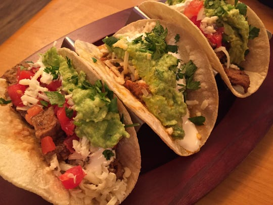 These three tacos have three different meat fillings. You can build your own taco, burrito, torta or plate at Guacamole Authentic Mexican Taqueria in East Rochester.