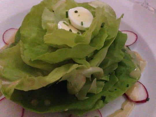 The house salad at Bistro de Margot in Burlington has bibb lettuce and quail egg.