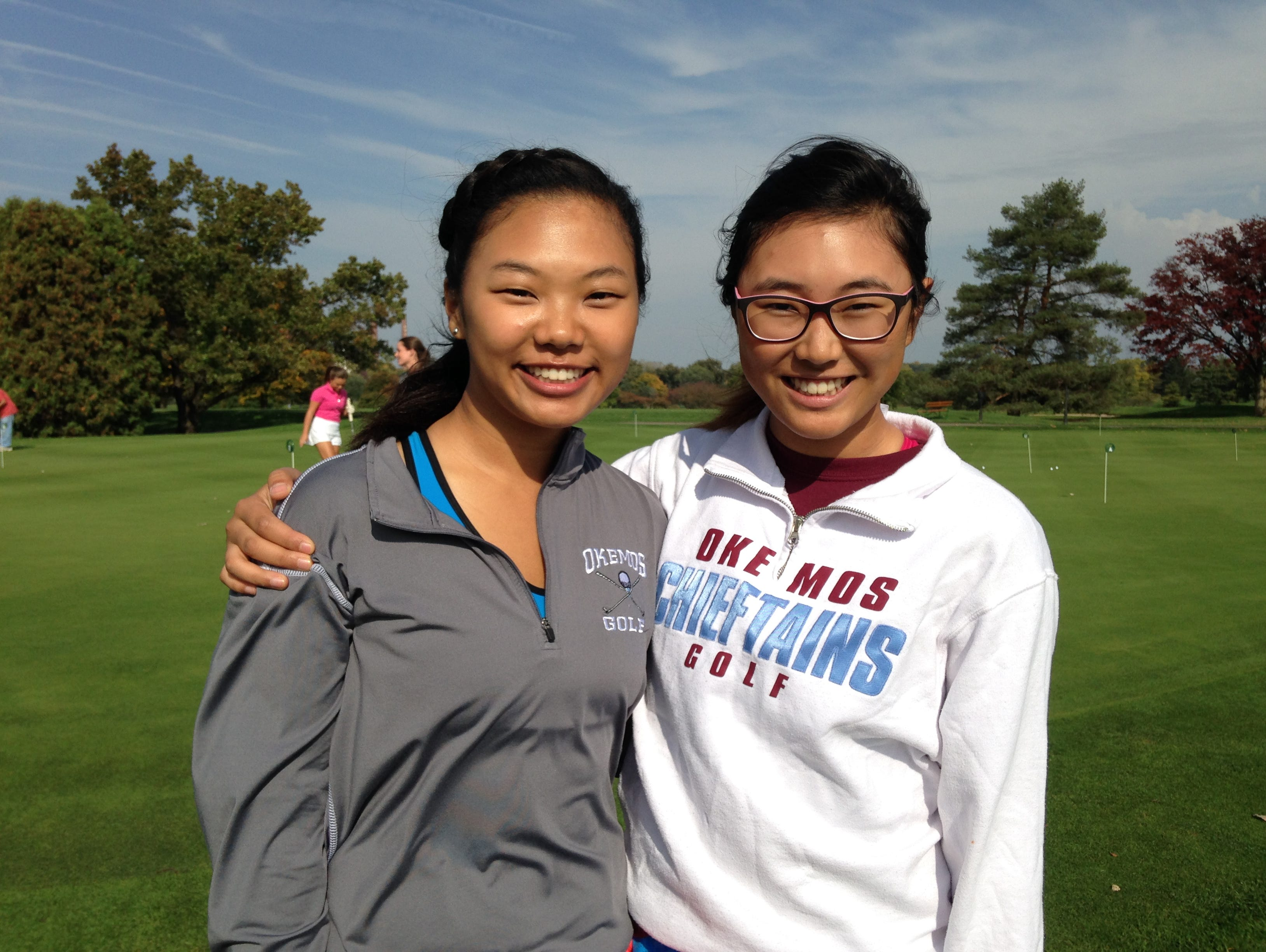 Sisters Jessica (right) and Lauren Kim have been key components for the Okemos girls golf team, which has won CAAC Blue and regional titles this season.