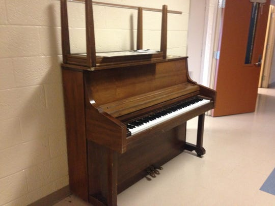 """One of two upright pianos for sale at Algonac Community Schools """"garage sale"""" event on Saturday at the former Algonac Elementary building, 5200 Taft Road in Clay Township."""