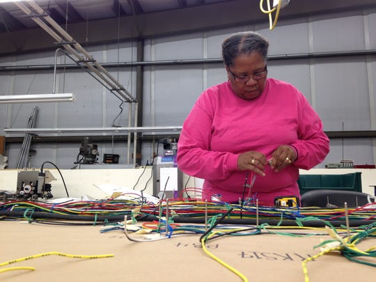 Cecilia Brown assembles a wiring harness Friday at