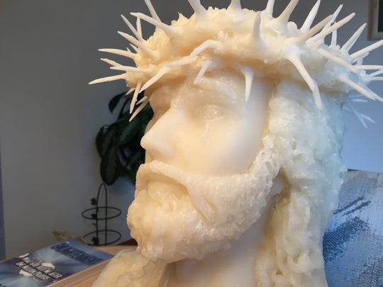 John Eagan's wax bust of Jesus, made from recycled church candles, features an accidental tear under the left eye.