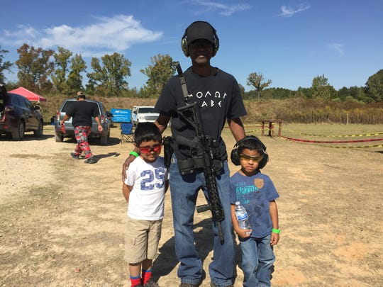 Roderick Davis (center) brought his sons, Isaiah and