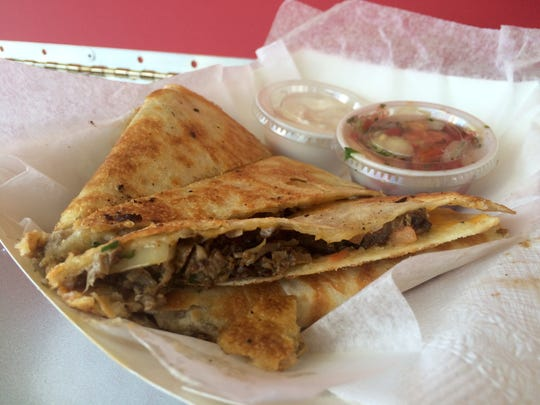 A quesadilla made from soy-balsamic marinated steak