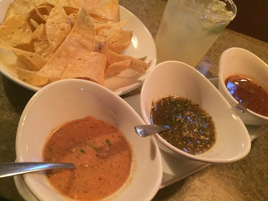 Delicia's earthy and nutty pumpkin seed salsa (far left) is part of a salsa trio with tortilla chips.