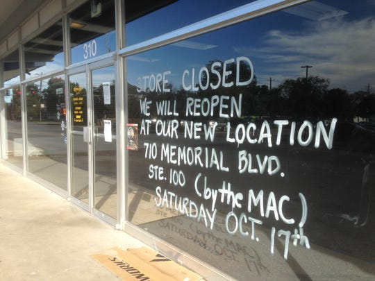 This window sign explains how a bike shop on the east side of Maple Street between Lytle and Burton streets relocated to clear the way for a future Rutherford County Judicial Center that's supposed to open by June 2018. County contractors will spend about a month tearing down the existing older buildings.