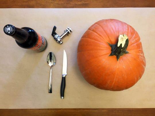 Items needed to make a pumpkin beverage dispenser.