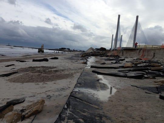 The approach road at the old Indian River Inlet Bridge after Hurricane Sandy. The road was destroyed. The old bridge was later removed and sand was pumped in to rebuild the beach and create a buffer for the new road and bridge. Oct. 30, 2012.