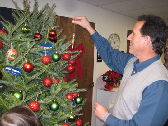 Santorum wears his sweater vest at a campaign office Christmas party in Urbandale in 2011.