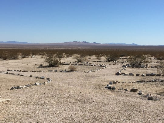 Rocks line walkways and tent areas at Camp Iron Mountain, one of 13 divisional training camps that operated within the massive Desert Training Center during World War II. Oct. 22, 2015.