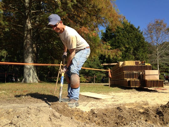 Salisbury attorney John Seipp helps fill a trench at