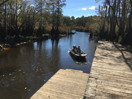 Leon Morris of Wewahitchka returns to shore after a morning of fishing on the Dead Lakes.