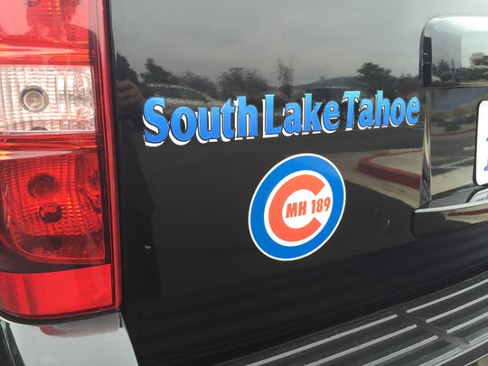 "Vehicles sported logos similar to South Lake Tahoe Police Officer Mark Hounsell's favorite team, the Chicago Cubs. The logo was altered to also read ""MH 189"" for Mark Hounsell and his badge number."