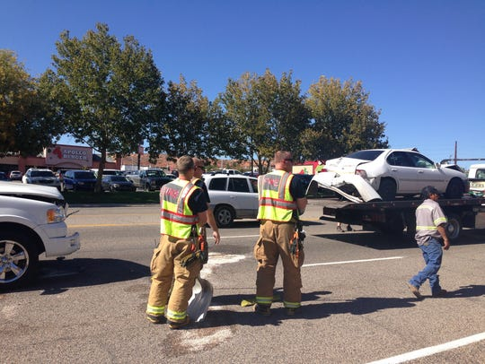 The St. George Fire Department cleans up a 3-car crash.