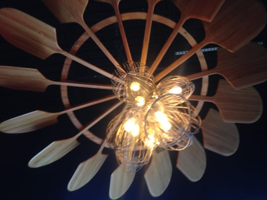Wood pizza paddles and Hobart wire whisks are part of a custom chandelier at Fine Folk Pizza in Gateway.