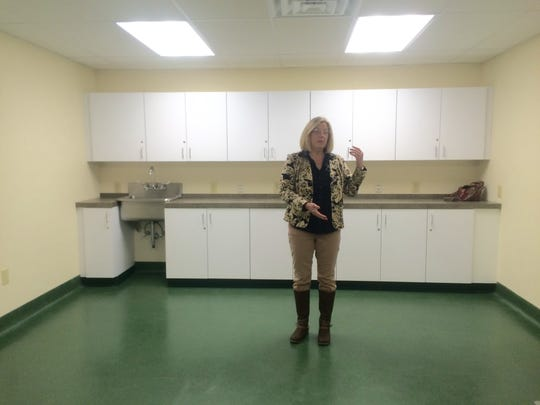 People for Animals Executive Director Jane Guillaume shows a room at the clinic that will be used by shelter staff to perform diagnostics on animals.