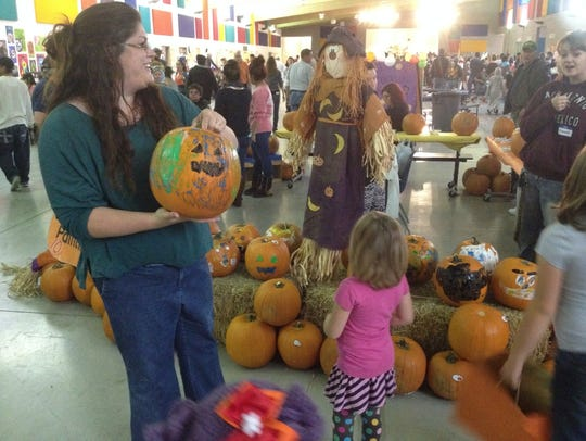Kids loved the chance to paint their own pumpkins to