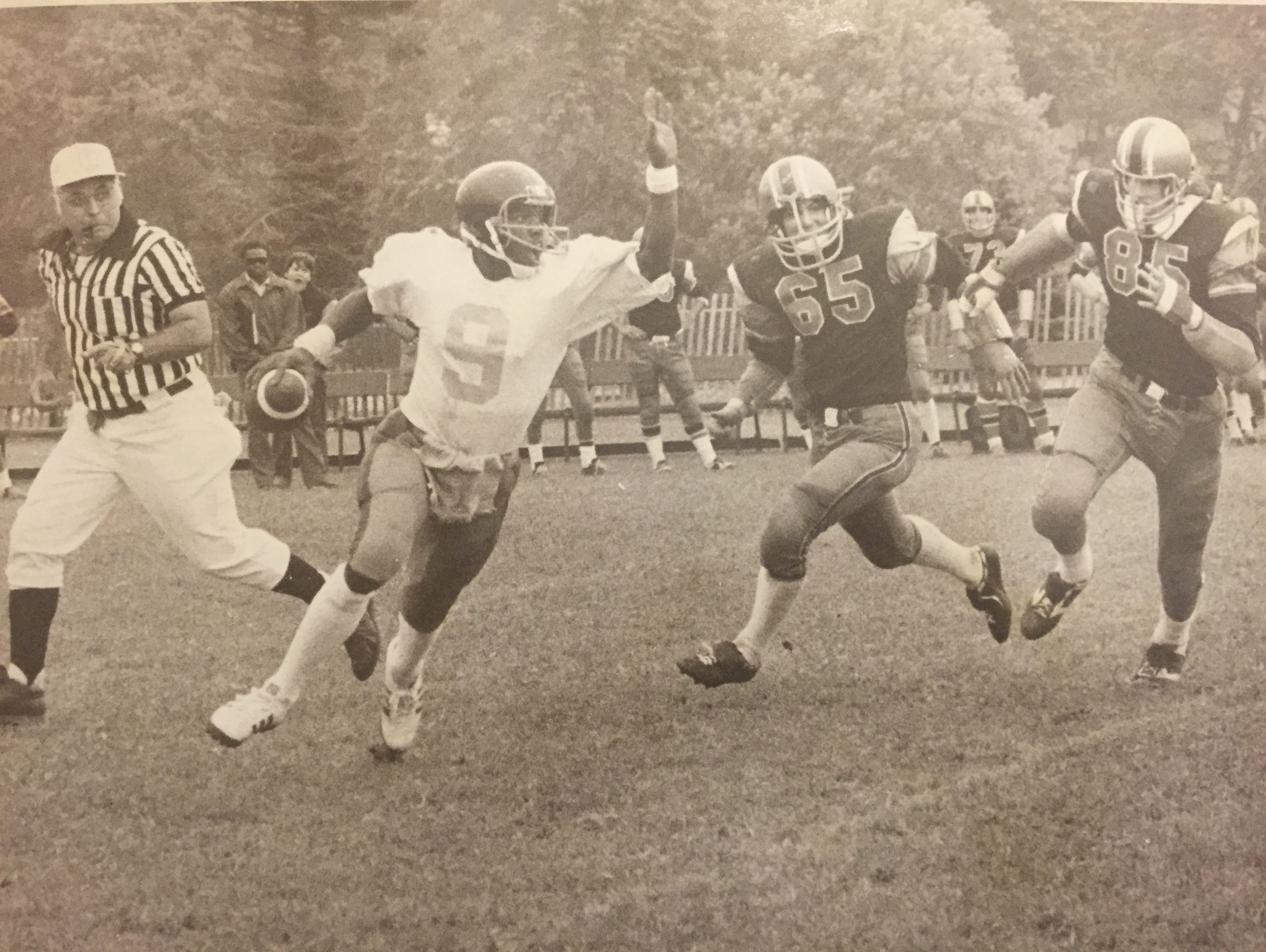 Asbury Park quarterback Timmy White (6) rolls out against Marlboro in a 1977 game.