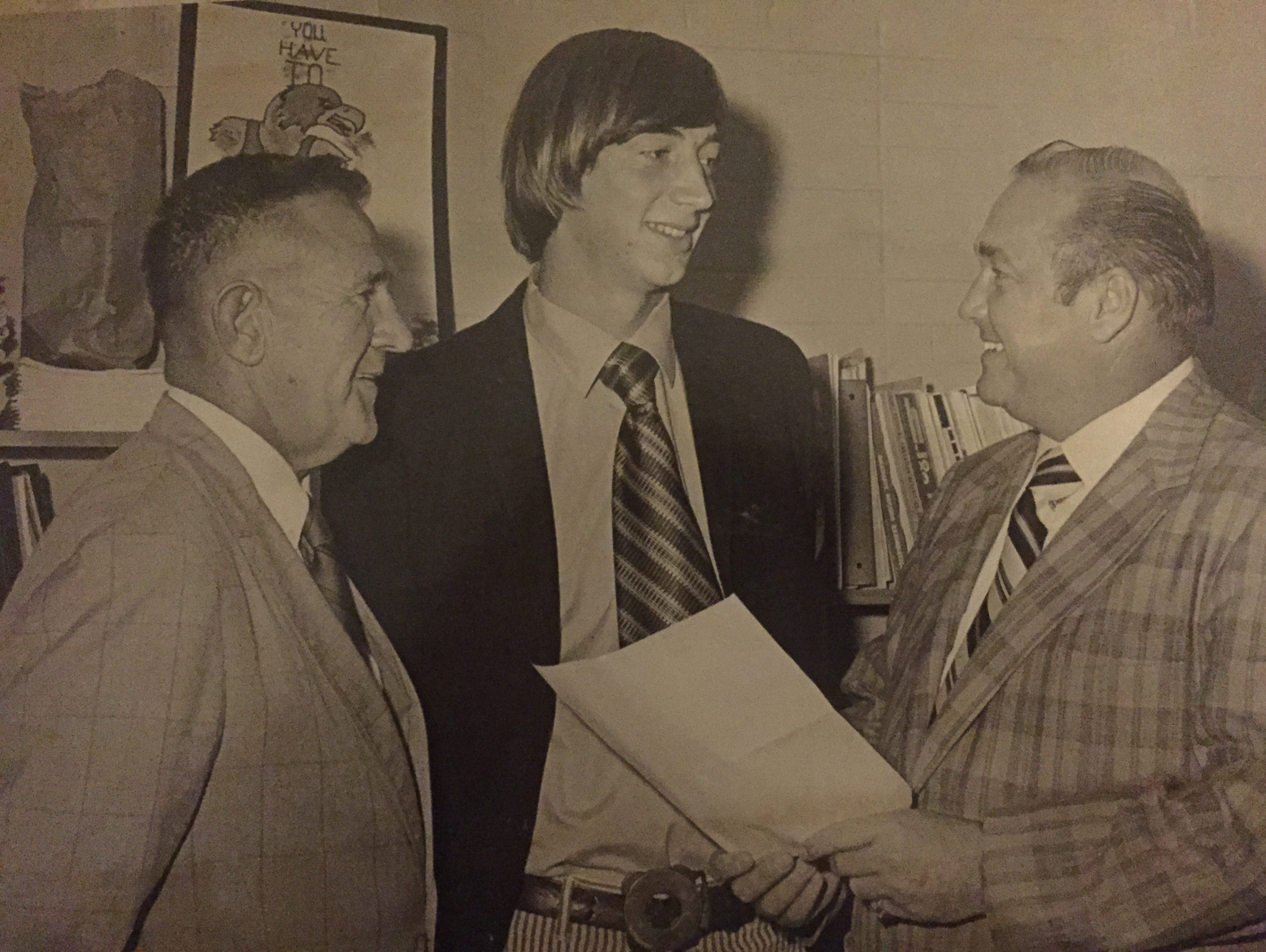 Central quarterback Robbie Keyes (center) receives the WJLK Player of the Week award in 1971, flanked by head coach Joe Boyd (left) and Pau Larson (right), owner of Larson Ford in Lakewood, the sponsor of the award.