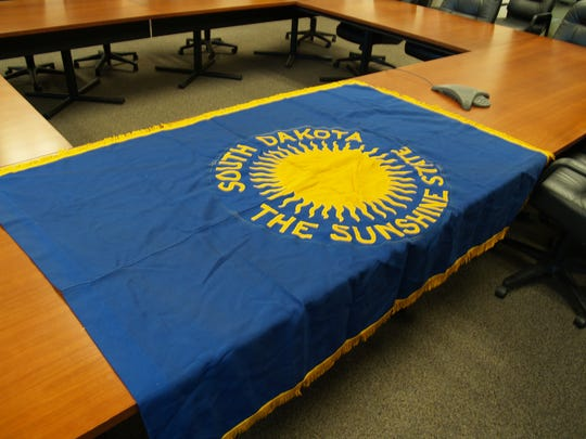 One side of the original South Dakota state flag that