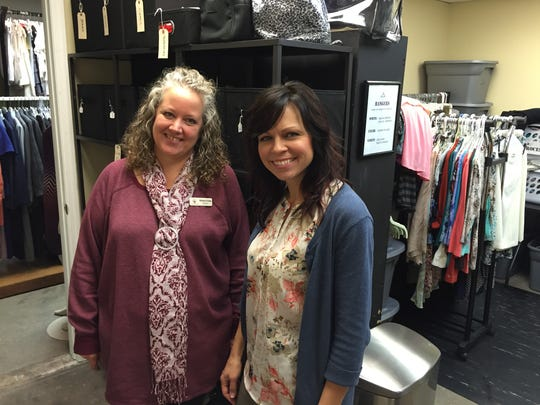 Possibility Place Director Sonya Craig, left, and Amelia's Closet Director Jody Powers stand in the showroom of the clothes closet.
