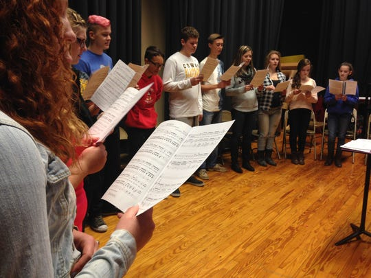 The 7th and 8th grade choir practices on the stage at Cowan Jr/Sr High School. Principal Patrick Bloom said he is trying to find a better place for the class by next school year.