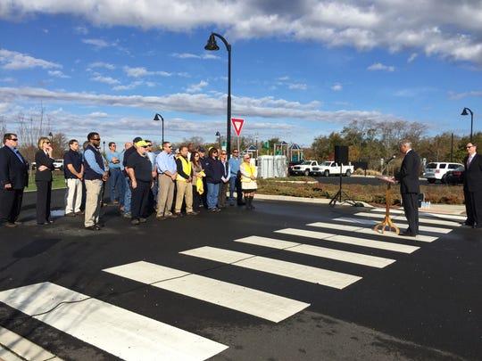 New Jersey Natural Gas employees and officials listen to BPU president Richard Mroz speak about infrastructure.