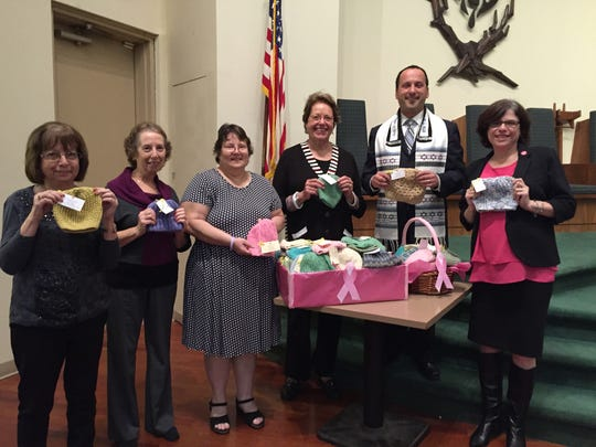 """Temple B'nai Shalom in East Brunswick hosted a """"Pink"""" Shabbat service on Oct. 23 in recognition of National Breast Cancer Awareness Month.  One in 40 Jews of Ashkenazi descent carries a BRCA (breast cancer) gene mutation, making Jewish families at ten times greater risk than the general population. Featured speaker (right) was Melissa Rosen, director of National Outreach of Shasheret, the Jewish community response to breast cancer.  Fredda Fleischman, Zeena Fleischman and Lillian Moore (left to right) of the Temple B'nai Shalom Sisterhood's Crafty Ladies group also presented 100 hand-crocheted, colorful chemo caps to be donated to the Regional Cancer Care Associates office of Dr. Michael Nissenblatt for use by cancer patients across central New Jersey.  The evening was organized by Harriet Golub (fourth from left) and the service was conducted by Rabbi Eric Eisenkramer (second from right) of Temple B'nai Shalom.  Temple B'nai Shalom is a Reform congregation located at 15 Fern Road in East Brunswick."""