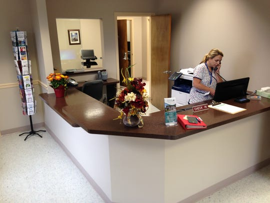 Cindy Conner, a radiology manager, answers the phone Wednesday at McCready Health's new Immediate Care Center in Princess Anne.