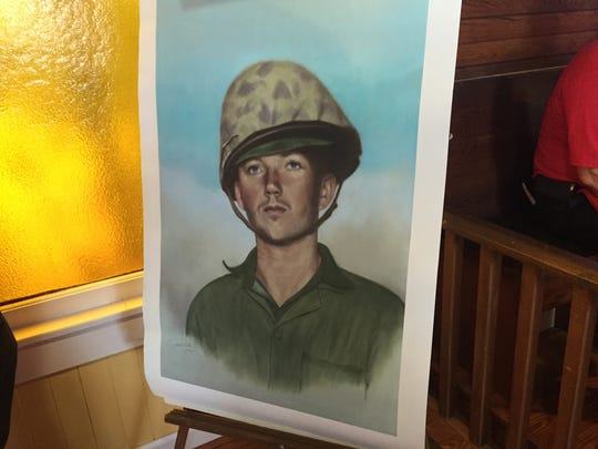 "A painting of Sgt. Ernest ""Boots"" Thomas on display in the Monticello Chamber of Commerce building."