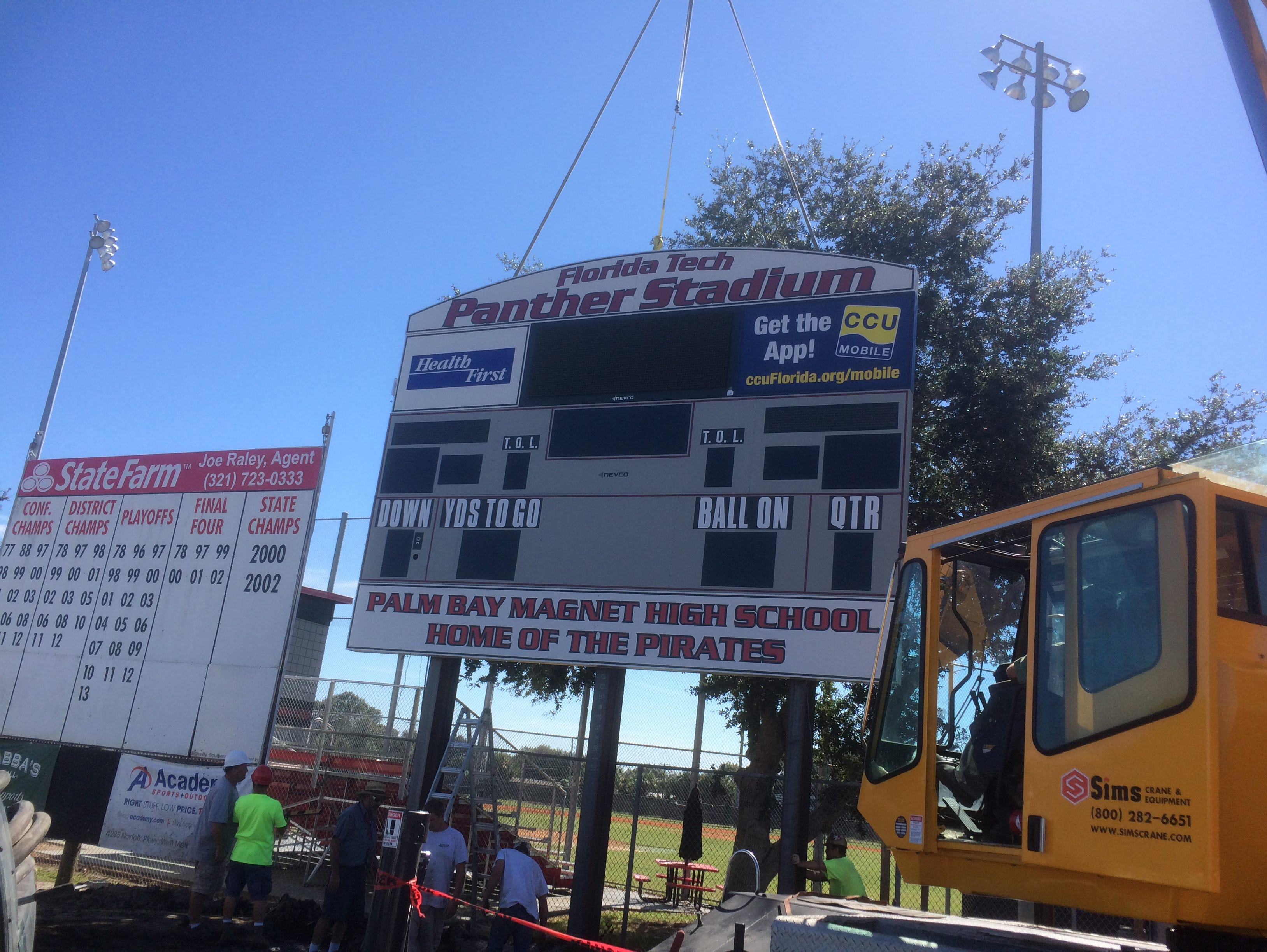 The new sign being installed at Palm Bay High School.