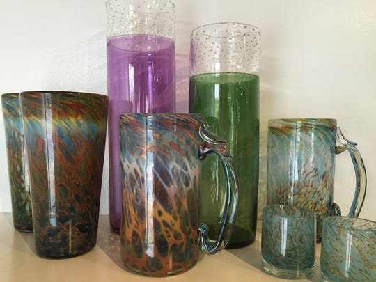 Beer mugs and pint glasses by Ben Greene and vases and shot glasses by Kathryn Adams at Asheville Glass Center.