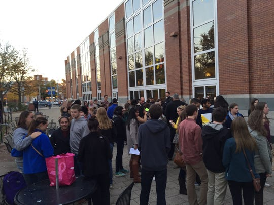 University of Delaware students gather for a vigil in honor of their critically injured friend Matthew Rosin, a sophomore at UD.