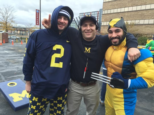 Michigan fans (from left) Jon Thomas, Jason Trzcinski and James Anderson before the Michigan-Minnesota game Oct. 31, 2015, in Minneapolis.