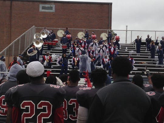 A few players hold up an L for Lane as their band plays for them after a 21-14 win Saturday over Kentucky State.