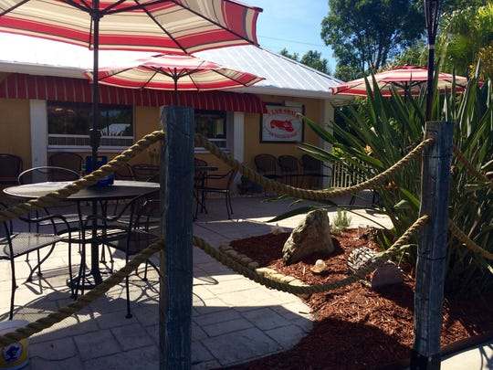 The Clam Shack's front patio is lined in striped umbrellas and thick ropes.