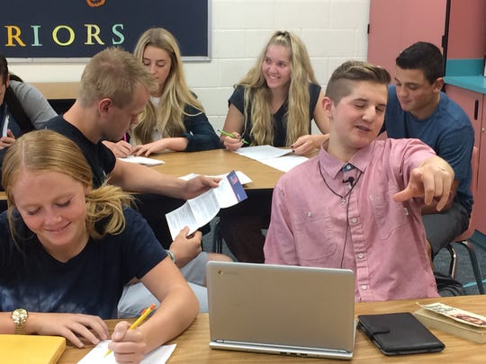 Snow Canyon High School student Britton Shipp mugs for the camera Monday during class.
