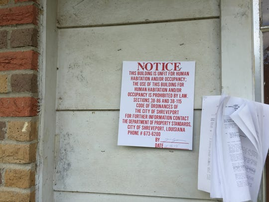 Notice on a home in the Martin Luther King made uninhabitable