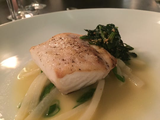 Restrained Recess style is realized in chef Greg Hardesty's balanced hand with buttered dashi broth and sesame-dressed spinach accompanying seared wild striped bass.