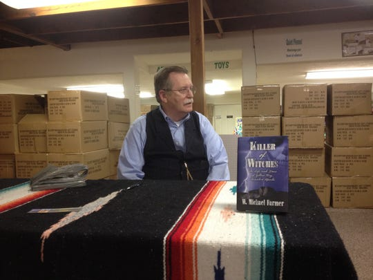 Killer of Witches author W. Michael Farmer was in town Wednesday for a book signing at Books Etcetera.