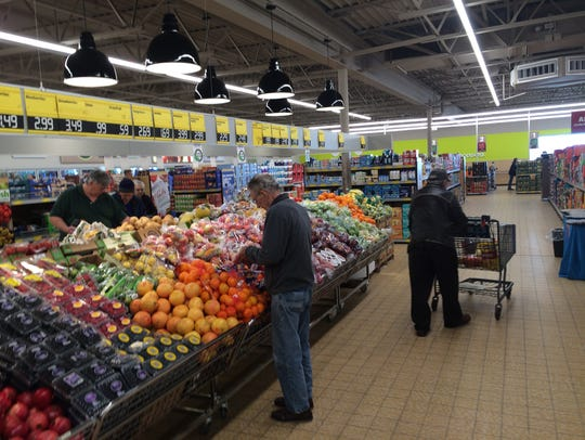 Customers go through the newly renovated ALDI grocery