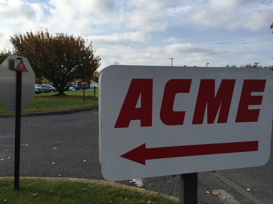 A new Acme sign stands in the parking lot of the former