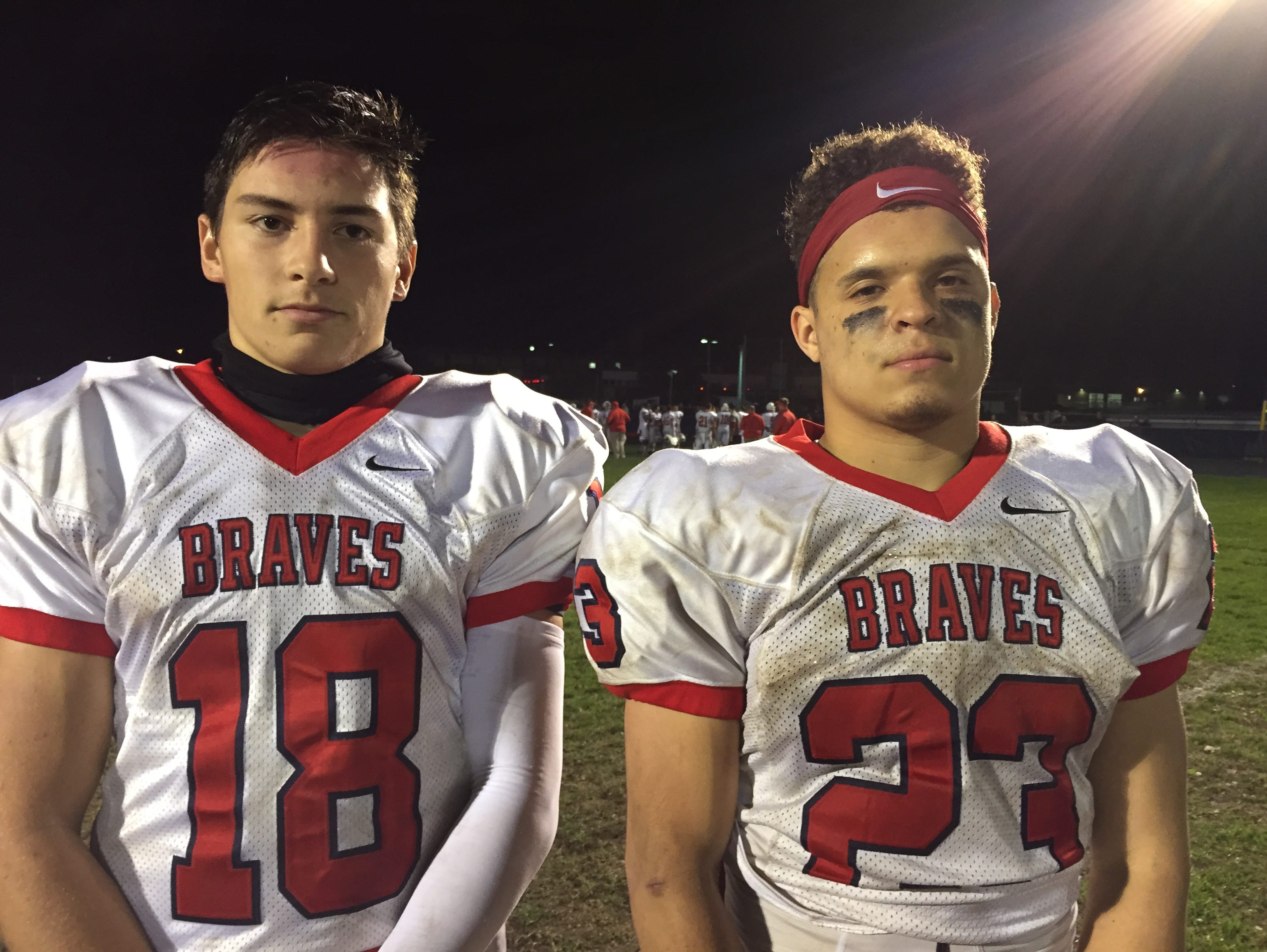 Quarterback Cody Wiener (left) and running back Marcus Salinas were all business after Manalapan rolled up Howell 42-0.